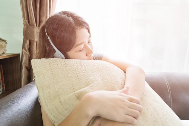 Asian woman short hair listening music