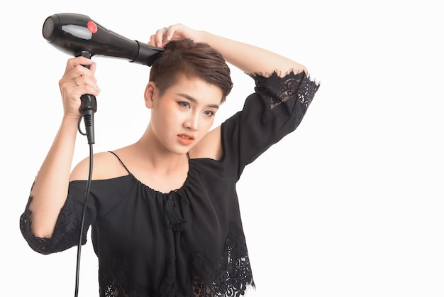 Asian woman shot hair use hair dryer on white