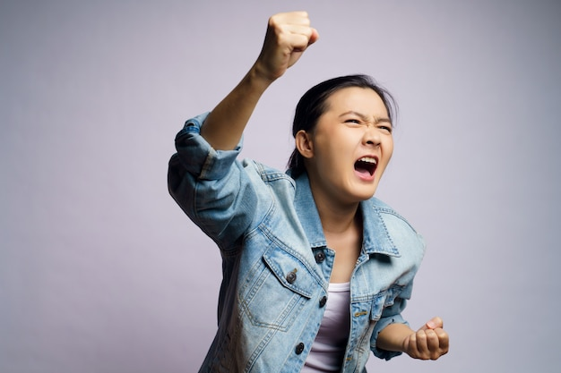 Asian woman shouting isolated.