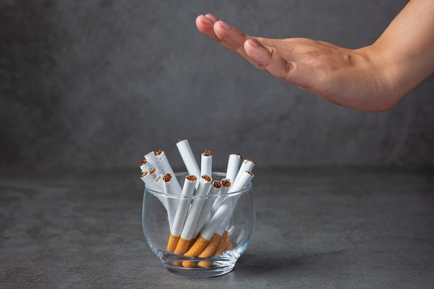 Asian woman showing hands stop to cigarette.world no tobacco day concept.