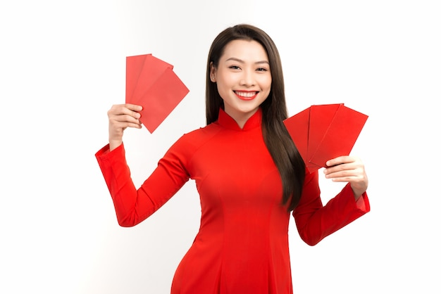 Asian woman showing red envelopes for lunar new year