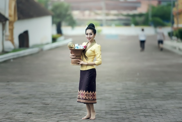 Asian woman in silk dress in temple