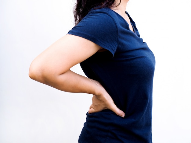 Asian woman suffering from back pain with muscle injury or chronic pain health and medical care