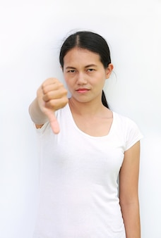 Asian woman in t-shirt showing down on white background