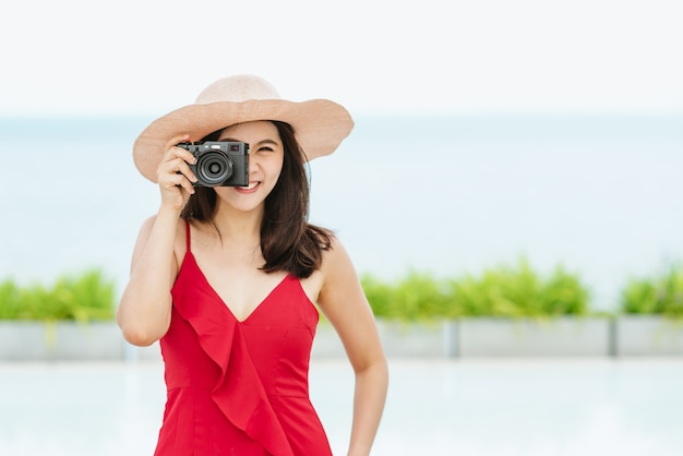 Asian woman taking a photo during her vacation