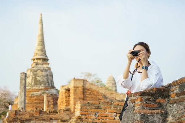 Asian woman taking photograph and traveling