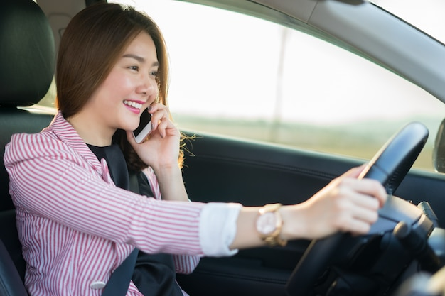 Asian woman talk by mobile calling on cellular phone