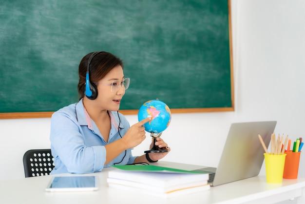 Asian woman teacher teaching through video conference