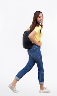 Asian woman teenage with school bagwalking on white background with casual dress