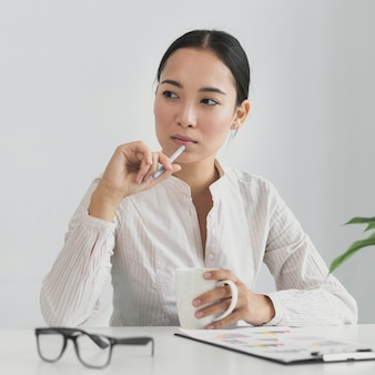 Asian woman thinking in the office