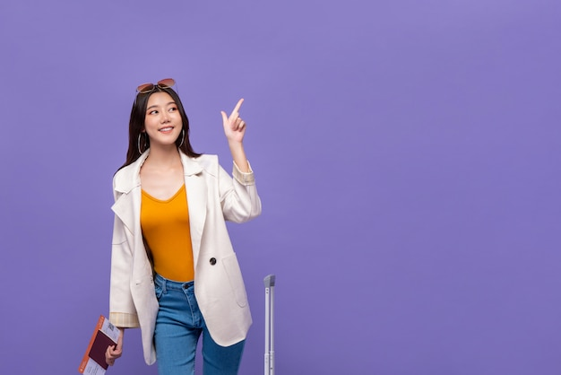 Asian woman tourist pointing hand to copy space