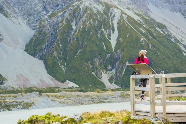 Asian woman travel enjoy at mt. cook national park in new zealand