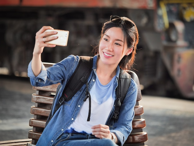Asian woman traveling with mobile phone
