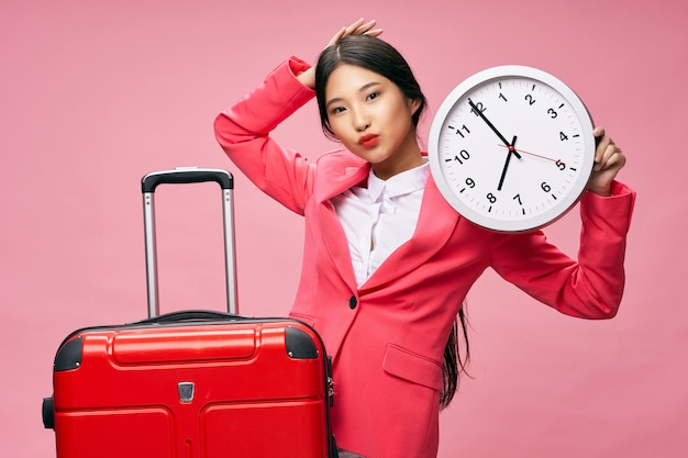 Asian woman travels with a suitcase in her hands, vacation,