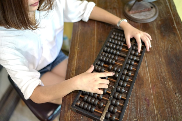 Asian woman using the abacus calculation