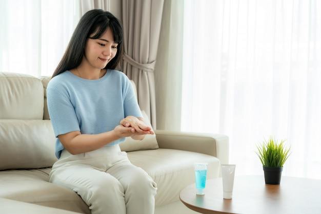 Asian woman using alcohol antiseptic gel, prevention, cleaning hands frequently, prevent infection, outbreak of covid-19 wash hands