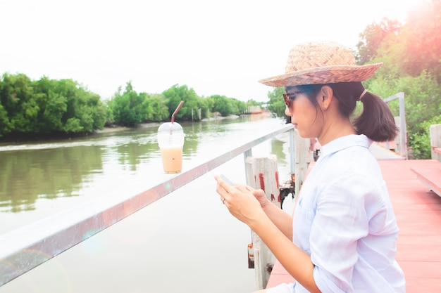Asian woman using mobile phone, lifestyle and travel concept