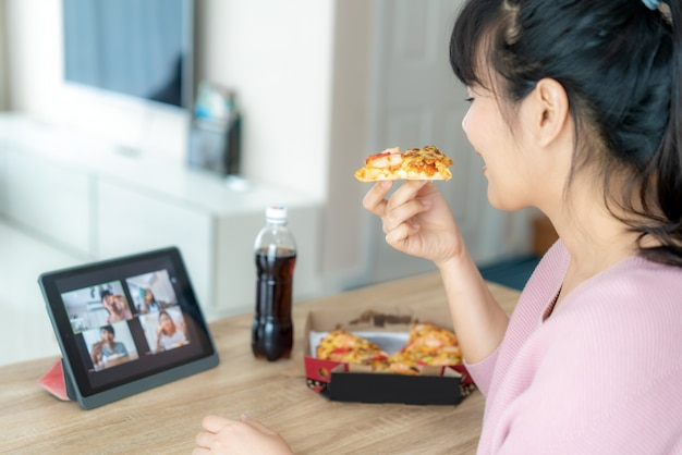 Asian woman virtual happy hour meeting party and eating food online together