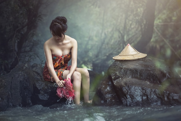 Asian woman was bathing in the brook, washing in the creek, country girl portrait in outdoors