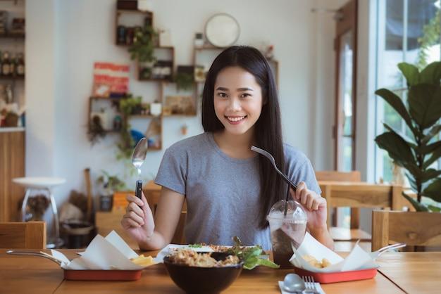 Asian woman was having breakfast in restaurants