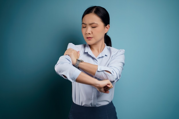 Asian woman was sick with body pain touching her body