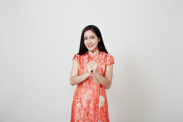 Asian woman wear cheongsam in chinese new year