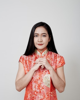 Asian woman wear cheongsam in chinese new year
