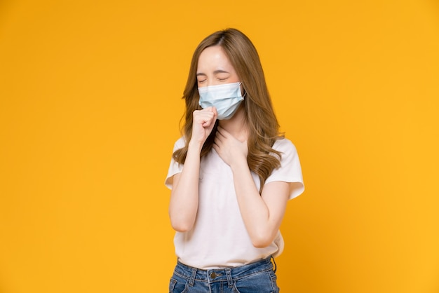 Asian woman wear masks to protect disease on yellow background.