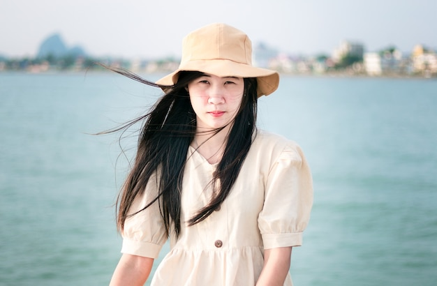Asian woman wearing a brown hat