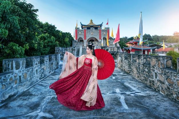 Asian woman wearing chinese traditional dress at baan santichon yunnan chinese culture in pai, mae hong son province, thailand
