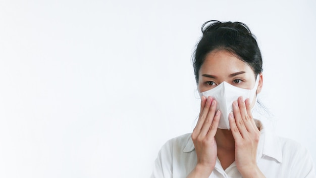 Asian woman wearing face mask to protect infection from coronavirus
