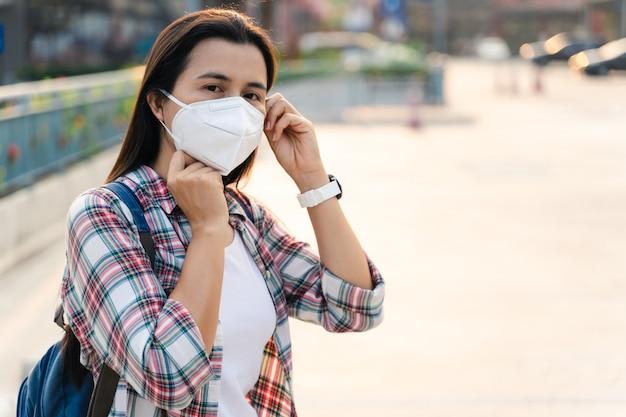 Asian woman wearing face mask to protect virus. covid-19 coronavirus concept.