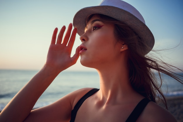 Asian woman wearing fashion straw beach hat for skin care sun protection