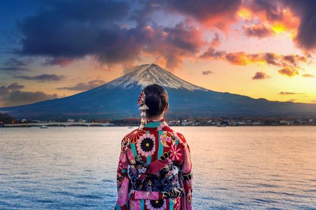 Asian woman wearing japanese traditional kimono at fuji mountain
