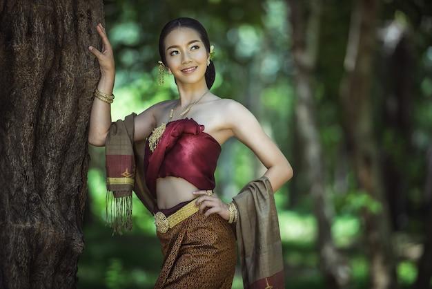 Asian woman wearing typical thai dress, vintage original thailand attire