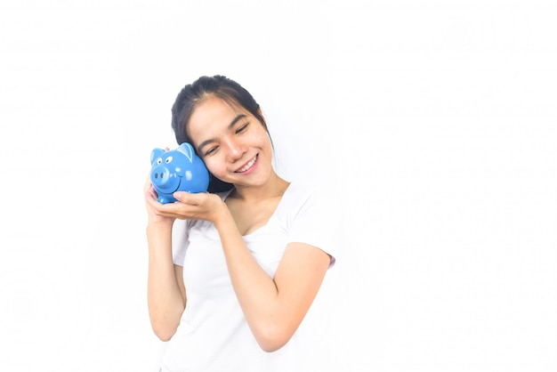 Asian woman on white background with holding piggy bank