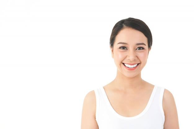 An asian woman with a beautiful and young smile and good skin. clean and healthy. beauty concept.  with copy space. white