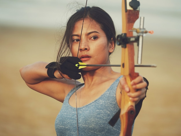 Asian woman with bow archery
