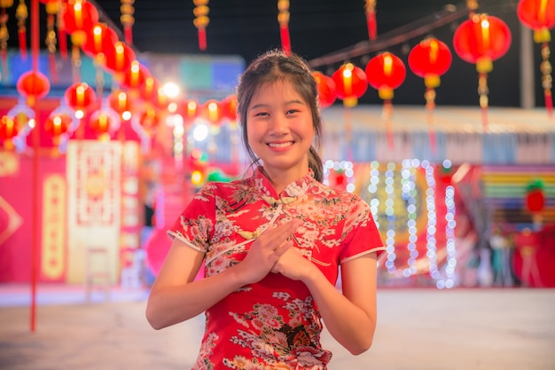 Asian woman with gesture of congratulation