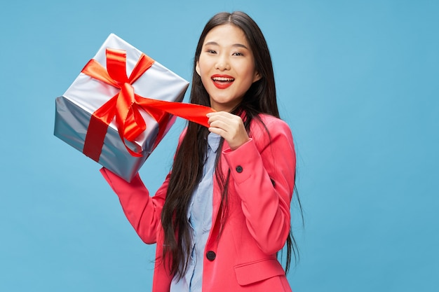Asian woman with gift boxes