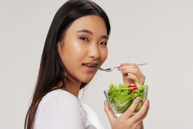 Asian woman with groceries