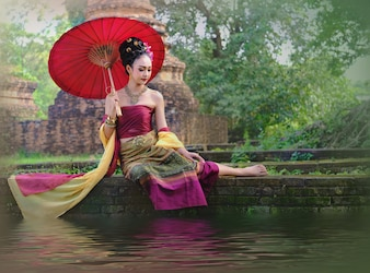 Asian woman with red umbrella