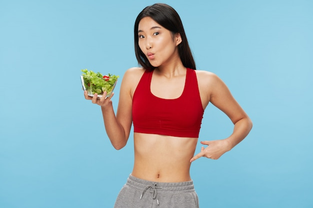 Asian woman with salad bowl