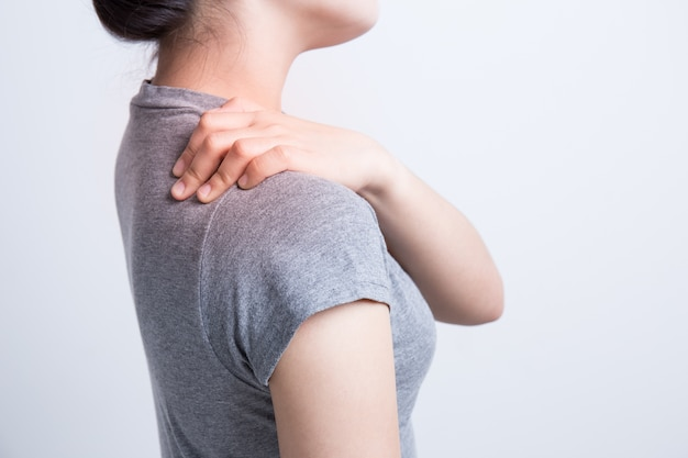 Asian woman with shoulder pain