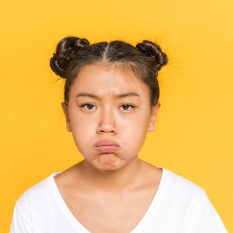 Asian woman with tied hair being upset