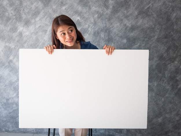 Asian woman with white banner copy space