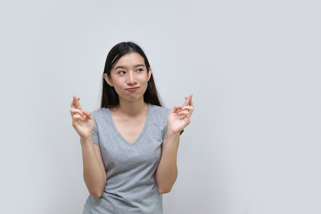 Asian woman woman fingers crossed, lying fake sign hand
