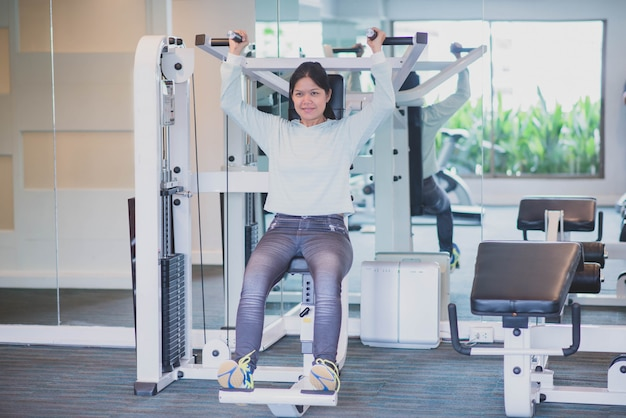 Asian woman work out exercise at gym weight loss