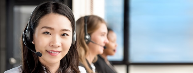 Asian woman working in call center with international team