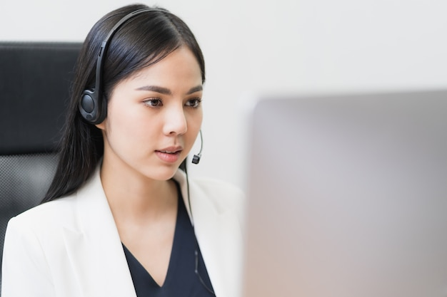 Asian woman working in a call centre